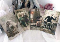 Quatre cartes postales anciennes couples Bonne Année.