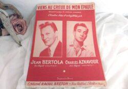 """Ancienne partition """"Au creux de mon épaule"""" d'Aznavour."""