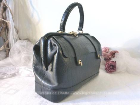 Ancien sac en cuir noir, à la belle forme des anciennes sacoches de docteur.