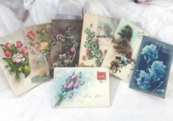 Lot de 7 cartes postales anciennes de fleurs pour souhaiter la Bonne Année .