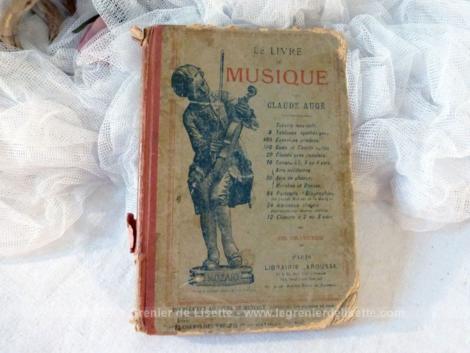 """Ancien livre """"Le Livre de Musique"""" par Claude Augé de 1889 avec partitions et 220 petites gravures."""