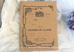 Ancien cahier scolaire de Devoirs de Classe rempli avec ses exercices et ses corrections et datant de 1910.
