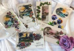 Lot de 6 cartes postales anciennes sur papier glacé. Elles représentent toute une petite photo, dessin d'un paysage habillée par de grandes gerbes de fleurs.
