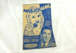 """Voici une ancienne partition de la chanson""""Marjolaine"""" chanté par 'André Claveau avec copyright de 1943 aux éditions Paul Beuscher."""