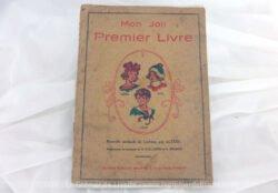 Ancien livre scolaire Mon Joli Premier Livre, livre typique d'apprentissage de la lecture dans les années 50 avec la nouvelle méthode de lecture par Alyère avec en couverture Léna, Riri, et Néné.