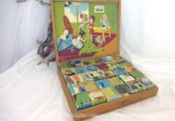 Ancien jeu de cubes vintage des années 60 en bois dans leur boite d'origine proposant des scènes de jeux d'enfants. Très émouvant....
