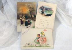 Trois anciennes cartes de souhait pour la Bonne Année des années 30, dont une photo colorisée et deux dessins.