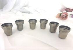 """Un lot de six anciens godets à liqueur en métal argenté forme évasée et décoration style """"Empire""""."""