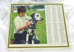 Ancien almanach des P.T.T. de 1974 avec la photo d'un enfant avec un dalmatien avec 10 feuillets supplémentaires sur le departement de Meurthe et Moselle.