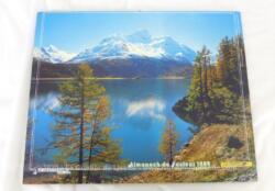Ancien almanach des P.T.T. de 1989 avec des photos de lacs des 2 cotés. Il y a 12 feuillets supplémentaires plus un grand poster de Madonna agrafé au centre.
