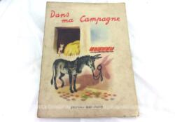 """Voici un ancien livre pour enfant """"Dans ma Campagne"""" de 1948 avec tranche usée par le temps."""