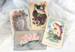 """Voici quatre cartes postales """"Poisson d'Avril"""" avec poissons, fleurs en reliefs ou en surbrillance et dessins humoristiques."""