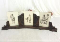Vraiment unique... le cadre en bois en forme d'arc de 50 x 13 x 6 cm et ses trois photos d'enfants avec encadrement en taille décroissante.